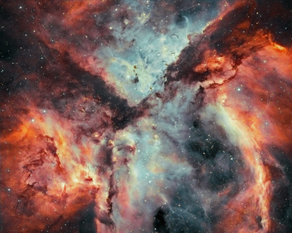 Stars, Gas, and Dust Battle in the Carina Nebula